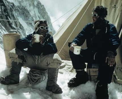 Tenzing Norgay and Edmund Hillary drink tea in the Western Cwm after their successful ascent of Mount Everest