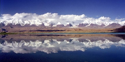 Mt. Kongur in China (climbed by my father's expedition in 1981), seen across Lake Karakul.