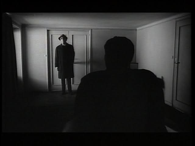 The Trial - man blocking door