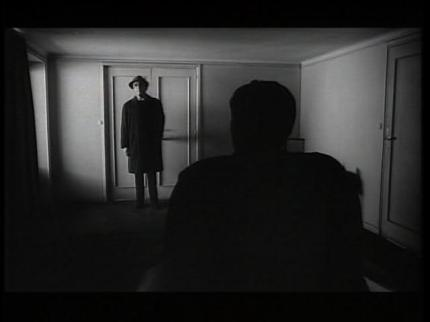 The Trial - man blocking door