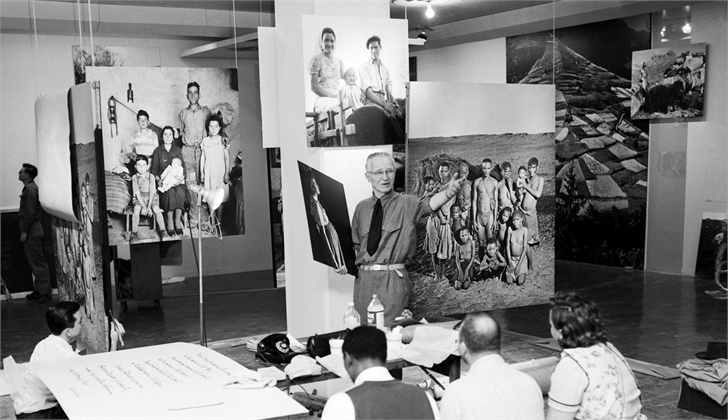 Steichen in 1955 assembling an exhibition of photos for New York's Museum of Modern Art.