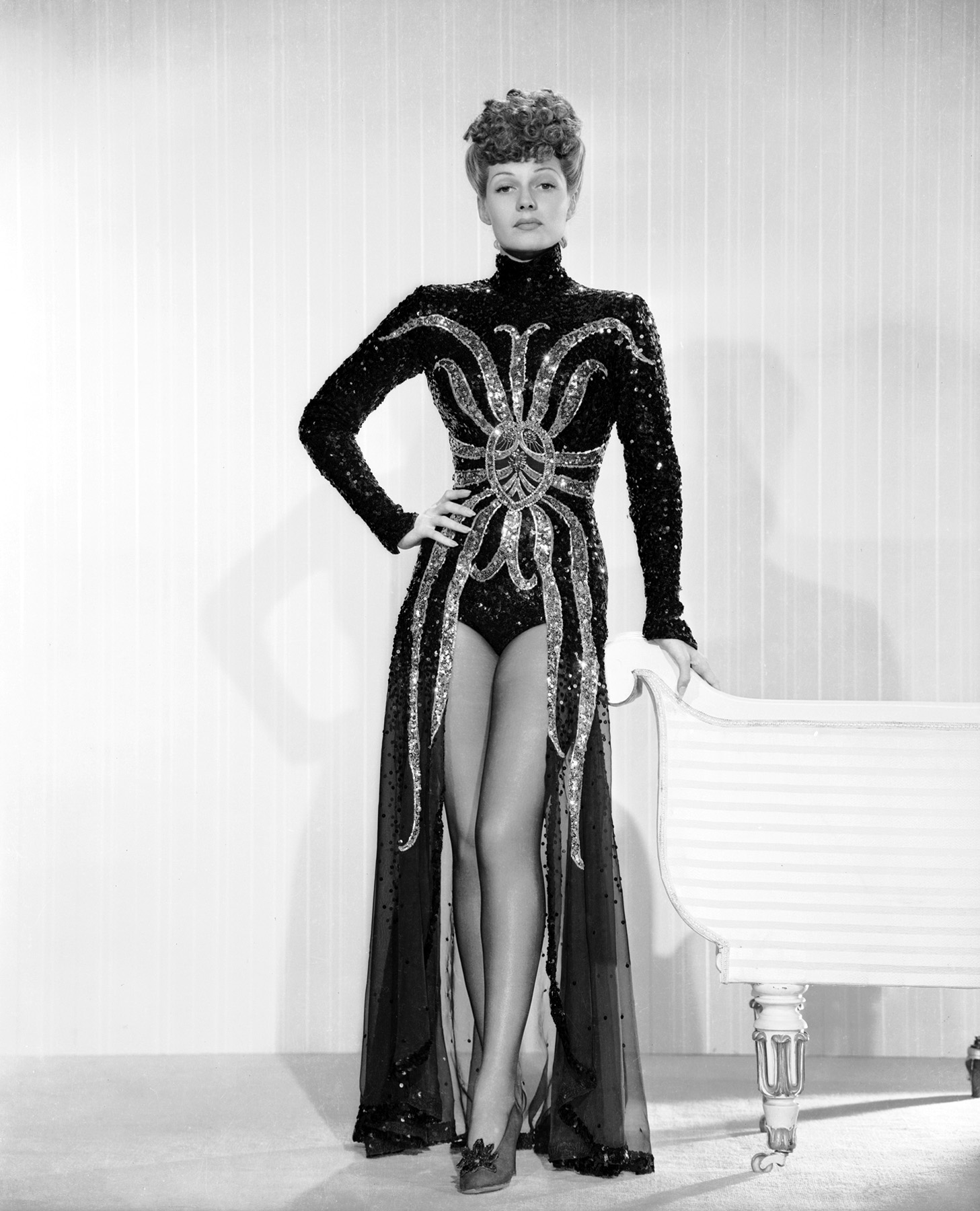 1942: Rita Hayworth (1918 - 1987) models a sequined gown with a spider-like motif in 'My Gal Sal', directed by Irving Cummings.