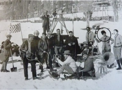 Crew filming the snowball fight. Note the camera mounted on a sled. Gance is circled.
