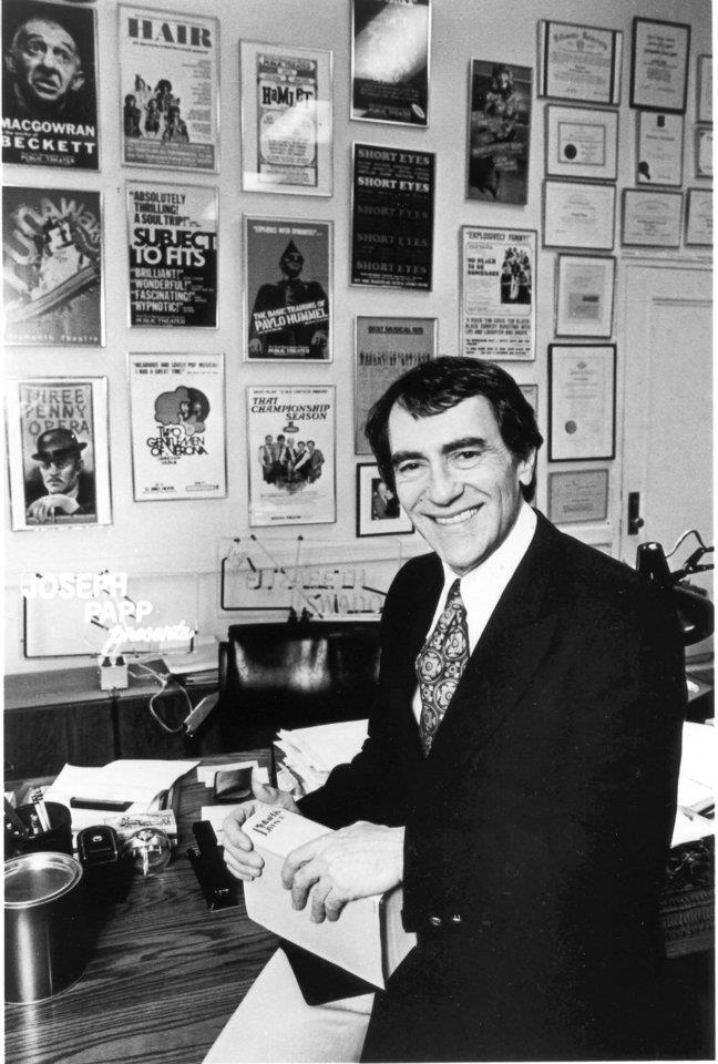 Joseph Papp in front of posters for his many legendary productions