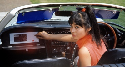 Bond girl Akiko Wakabasyashi behind the wheel of her one-off Toyota 2000 GT convertible