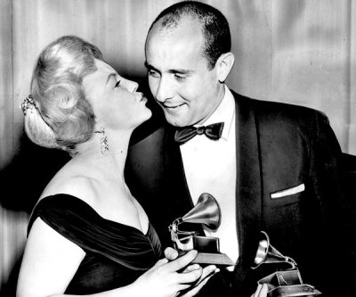 Henry Mancini receiving the Grammy for his album of music from Peter Gunn